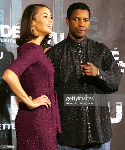 Actor Denzel Washington poses with actress Paula Patton during the Deja Vu Photocall on December 08 2006 in Hamburg Germany