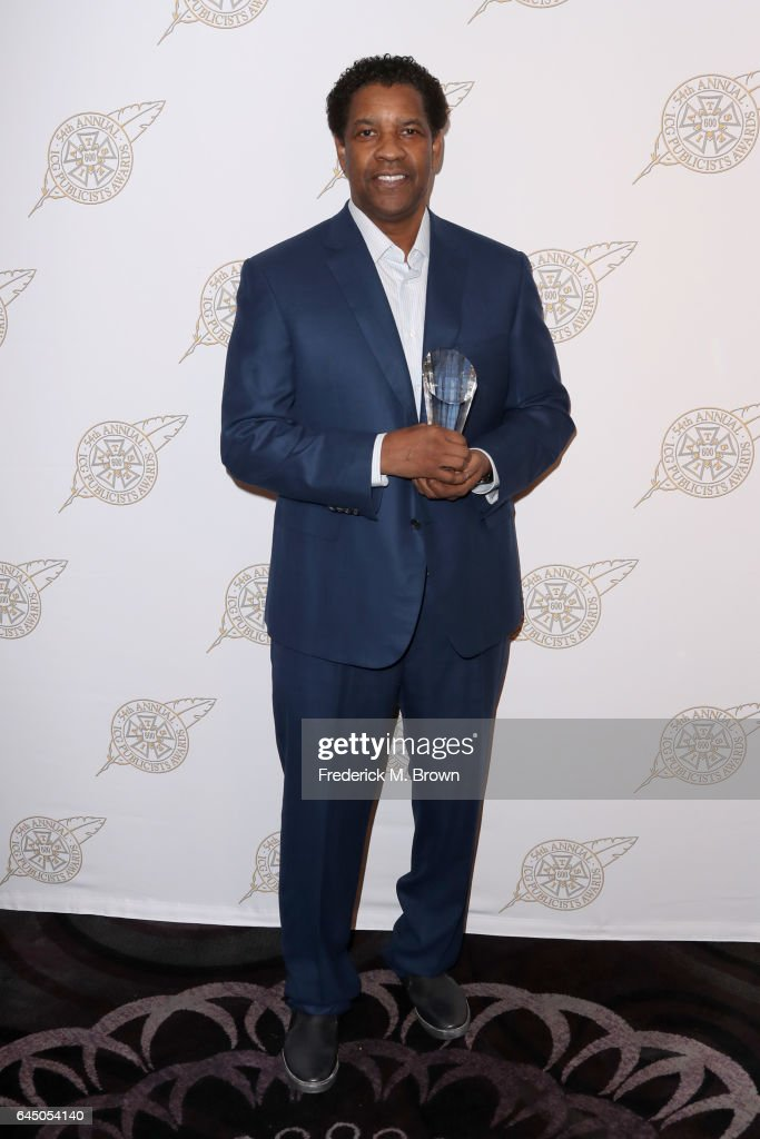 Actor Denzel Washington poses with his Motion Picture Showman of the Year Award backstage at the 54th Annual International Cinematographers Guild Publicists Awards at The Beverly Hilton Hotel on February 24, 2017 in Beverly Hills, California.