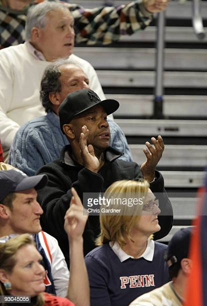 Actor Denzel Washington reacts as he watches the Penn State Nittany Lions basketball game against the Penn Quakers at the Bryce Jordan Center on...