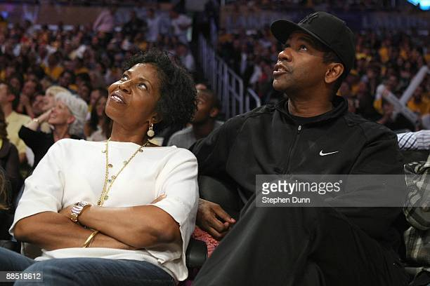Actor Denzel Washington sits courtside with his wife Pauletta Pearson to watch the Orlando Magic and the Los Angeles Lakers in Game Two of the 2009...