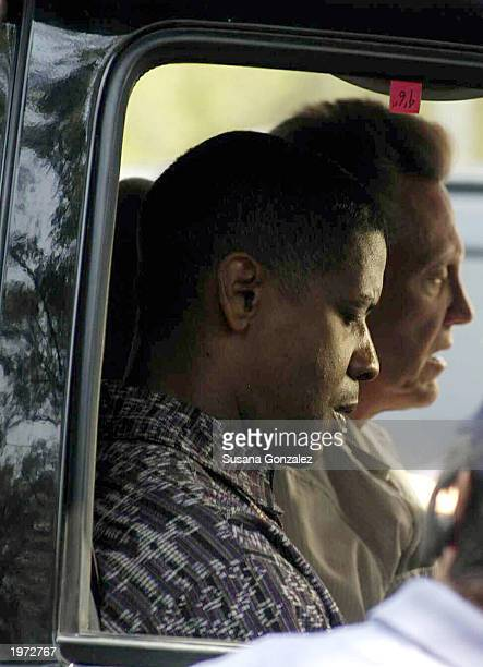 Actor Denzel Washington sits in a car with actor Christopher Walken as they film a scene of Man On Fire May 4 2003 in Mexico City Mexico