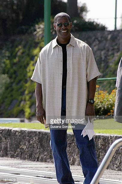 Actor Denzel Washington smiles before filming a scene of Man On Fire at a sports club May 5 2003 in Mexico City Mexico