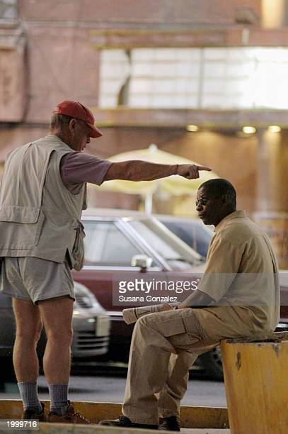 Actor Denzel Washington talks with director Tony Scott while filming a scene of the film Man On Fire May 14 2003 in Mexico City Mexico