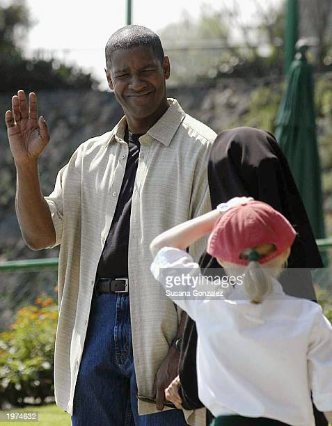 Actor Denzel Washington waves to other cast members while filming a scene of Man On Fire at a sports club May 5 2003 in Mexico City Mexico