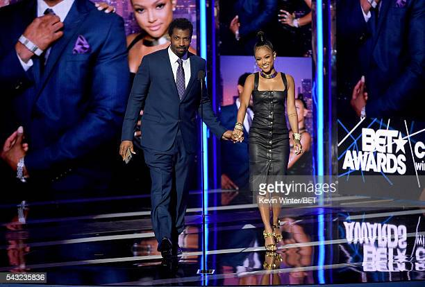 Actor Deon Cole and actress/model Karrueche Tran walk onstage during the 2016 BET Awards at the Microsoft Theater on June 26 2016 in Los Angeles...