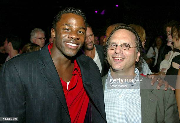 """Actor Derek Luke and book author Buzz Bissinger pose at the after-party for the premiere of Univeral's """"Friday Night Lights"""" at the Highlands on..."""