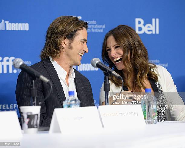 Actor Dermot Mulroney and actress Julia Roberts speak onstage at August Osage County Press Conference during the 2013 Toronto International Film...