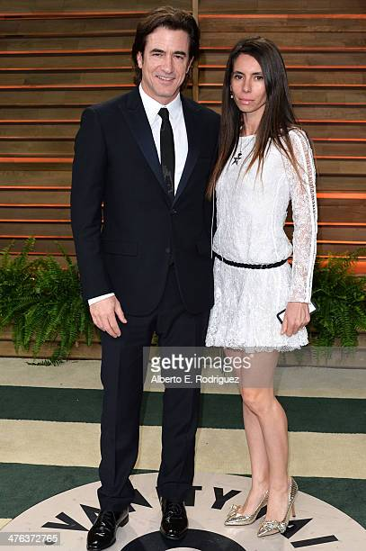 Actor Dermot Mulroney and producer Tharita Catulle attend the 2014 Vanity Fair Oscar Party hosted by Graydon Carter on March 2 2014 in West Hollywood...