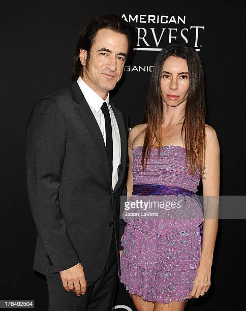 Actor Dermot Mulroney and wife Tharita Catulle attend the premiere of Jobs at Regal Cinemas LA Live on August 13 2013 in Los Angeles California