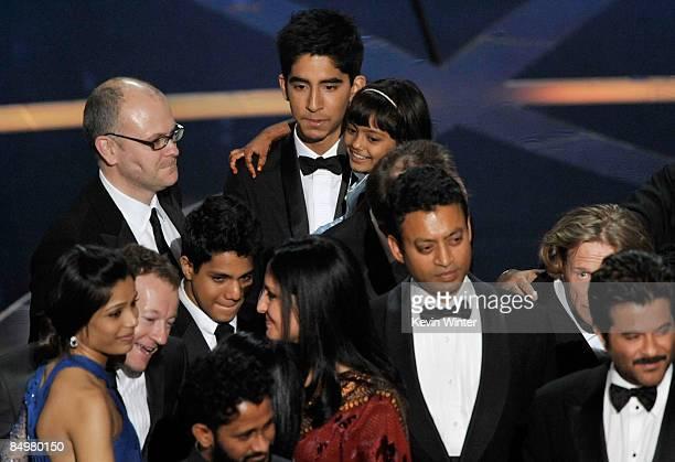 Actor Dev Patel holding actress Rubina Ali actress Freida Pinto actors Irrfan Khan and Anil Kapoor and cast and crew celebrate Slumdog Millionaire...