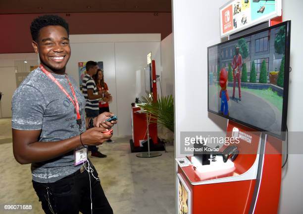 Actor Dexter Darden plays Super Mario Odyssey at the Nintendo booth at the 2017 E3 Gaming Convention at Los Angeles Convention Center on June 14,...