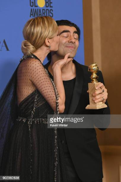 Actor Diane Kruger kisses director Fatih Akin and his award for Best Motion Picture Foreign Language for 'In The Fade' in the press room during The...