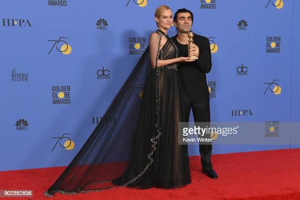 Actor Diane Kruger poses with director Fatih Akin and his award for Best Motion Picture Foreign Language for 'In The Fade' in the press room during...