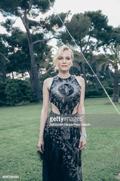 Actor Diane Kruger wearing an Alexander McQueen dress is photographed for Paris Match whilst attending the Amfar Gala at the Eden Roc Hotel on May 25...