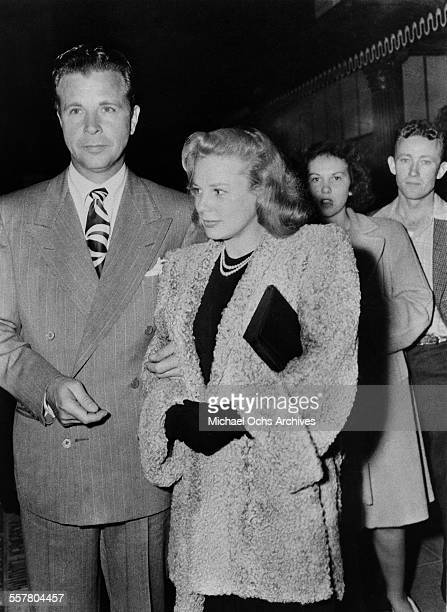 Actor Dick Powell with his wife actress June Allyson attend an event in Los Angeles California