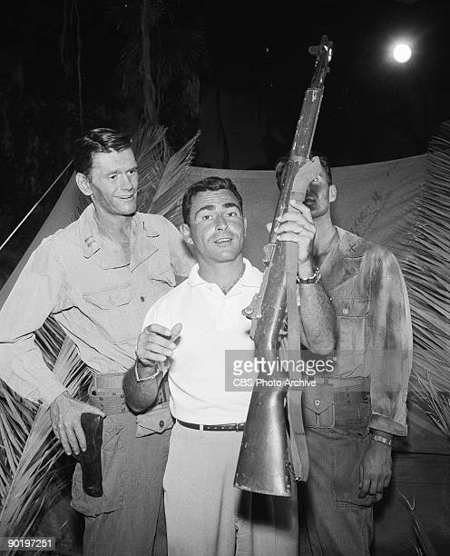 Actor Dick York as Captain Riker with director Rod Serling between scenes of 'The Purple Testament' episode 19 from season 1 of the science fiction...