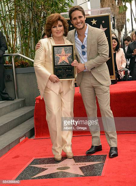 Actor Diego Boneta and honoree Angelica Maria at the Angelica Maria Star ceremony held On The Hollywood Walk Of Fame on May 25 2016 in Hollywood...