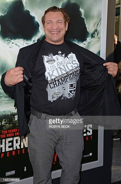 Actor Dimitri Diachenko arrives on the red carpet for a special screening of the Chernobyl Diaries at the Cinerama Dome in Hollywood California May...