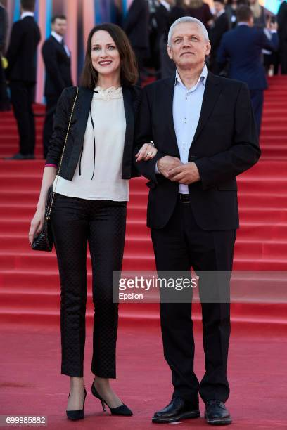 Actor director Alexander Galibin and his wife actress Irina Savitskova attend opening of the 39th Moscow International Film Festival outside the Karo...