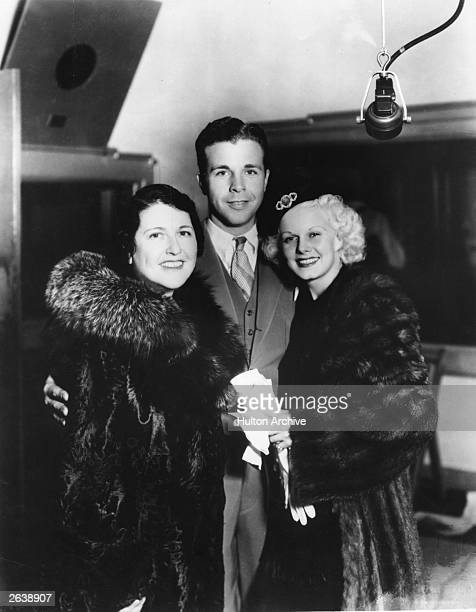 US actor director and producer Dick Powell founder of Four Star TV with movie columnist Louella Parsons left and US film actress Jean Harlow...