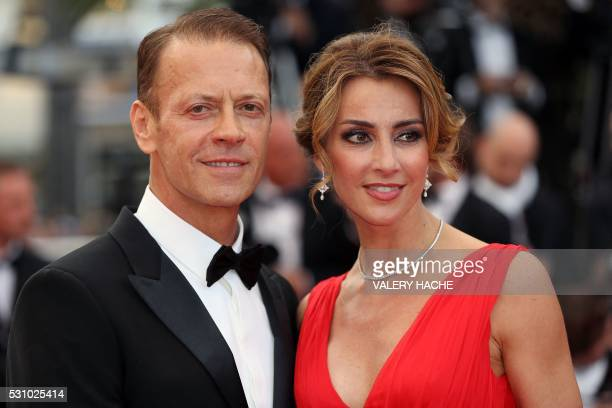 Actor director and producer Rocco Siffredi and his wife Rosa Caracciolo pose on May 12 2016 as they arrive for the screening of the film Money...