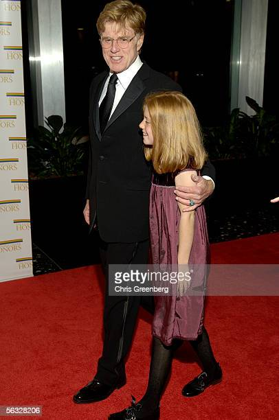 Actor Director Robert Redford escorts his grandaughter Lena Redford down the red carpet at the US State Department at a gala celebration for...