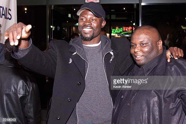 Actor Djimon Hounsou and castmember Ade at the premiere of 'Snatch' at the Directors Guild Los Angeles Ca 1/18/01