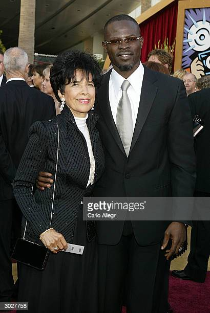Actor Djimon Hounsou and stepmother attend the 76th Annual Academy Awards on February 29 2004 at the Kodak Theater in Hollywood California