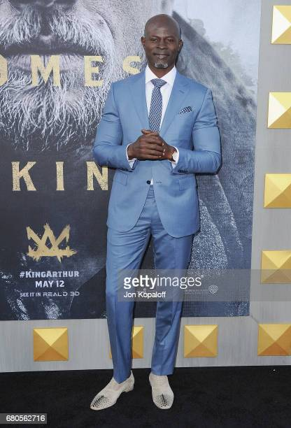 Actor Djimon Hounsou arrives at the Los Angeles Premiere 'King Arthur Legend Of The Sword' at TCL Chinese Theatre on May 8 2017 in Hollywood...