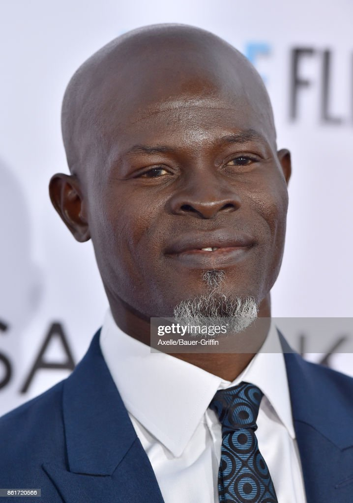 Actor Djimon Hounsou arrives at the premiere of 'Same Kind of Different as Me' at Westwood Village Theatre on October 12, 2017 in Westwood, California.