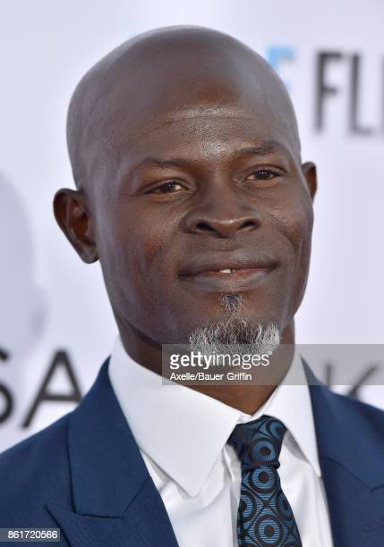 Actor Djimon Hounsou arrives at the premiere of 'Same Kind of Different as Me' at Westwood Village Theatre on October 12, 2017 in Westwood,...