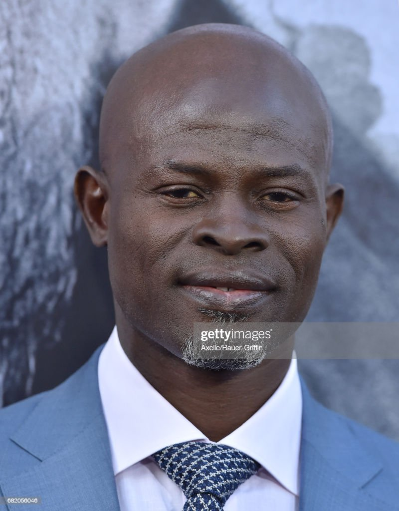 Actor Djimon Hounsou arrives at the premiere of Warner Bros. Pictures' 'King Arthur: Legend of the Sword' at TCL Chinese Theatre on May 8, 2017 in Hollywood, California.