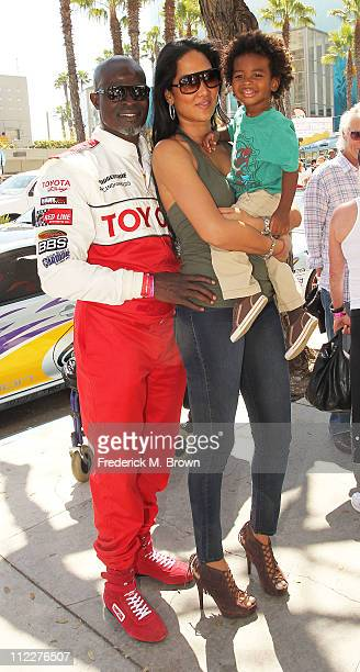 Actor Djimon Hounsou model/actress Kimora Lee and their son Kenzo Lee Hounsou attend the 35th Annual Toyota Pro/Celebrity Race on April 16 2011 in...