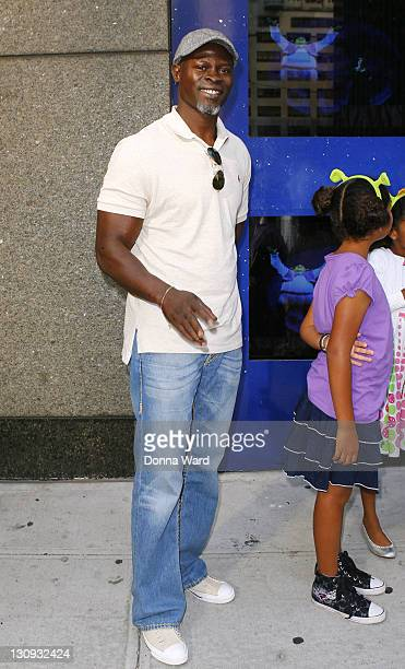 """Actor Djimon Hounsou visits """"Shrek The Musical"""" at the Broadway Theatre on August 15, 2009 in New York City."""