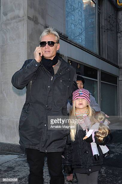 Actor Dolph Lundgren and his daughter Greta Eveline Lundgren walk on Madison Avenue December 24 2009 in New York City