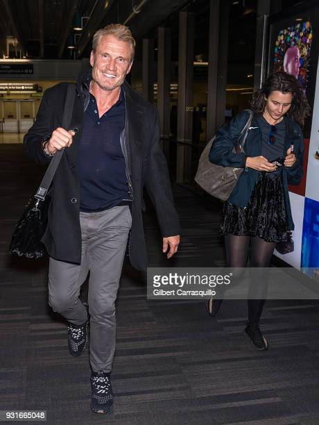 Actor Dolph Lundgren and Jenny Sandersson are seen arriving at Philadelphia International Airport on March 13 2018 in Philadelphia Pennsylvania