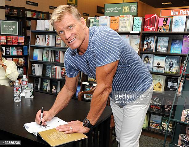 Actor Dolph Lundgren attends the signing of his new book 'Dolph Lundgren Train Like An Action Hero Be Fit Forever' at Barnes Noble on September 21...