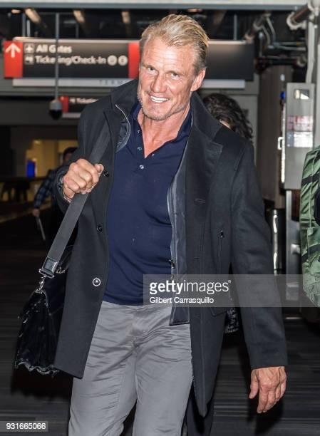 Actor Dolph Lundgren is seen arriving at Philadelphia International Airport on March 13 2018 in Philadelphia Pennsylvania