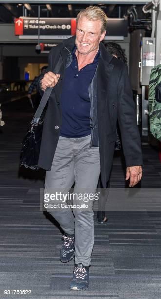 Actor Dolph Lundgren is seen arriving to Philadelphia International Airport on March 13 2018 in Philadelphia Pennsylvania
