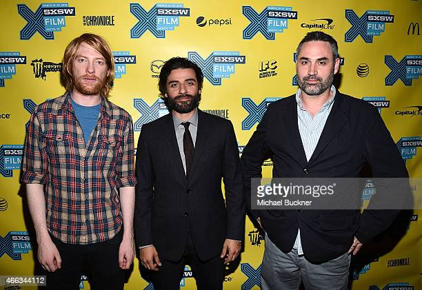 Actor Domhnall Gleeson actor Oscar Isaac and director Alex Garland arrive at the premiere of Ex Machina during the 2015 SXSW Music FIlm Interactive...
