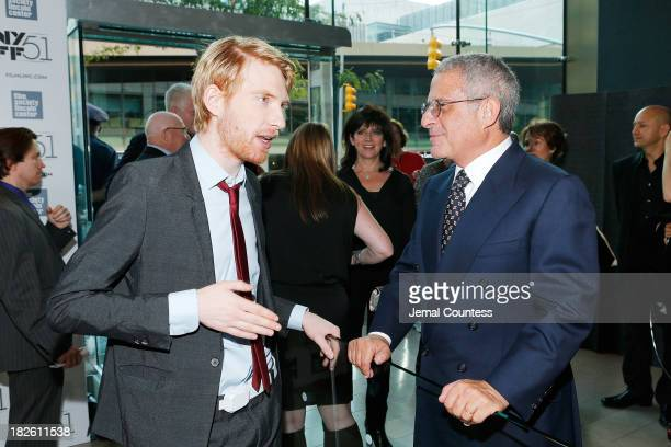 Actor Domhnall Gleeson speaks with NBCUniversal Vice Chairan Ronald Meyer at the About Time premiere during the 51st New York Film Festival at Alice...