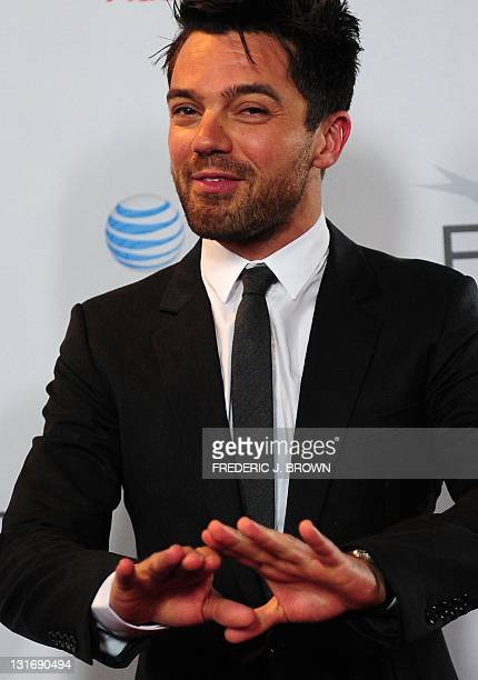 Actor Dominic Cooper gestures on arrival for the Gala Screening of the film 'My Life with Marilyn' at Grauman's Chinese Theater in Hollywood on...