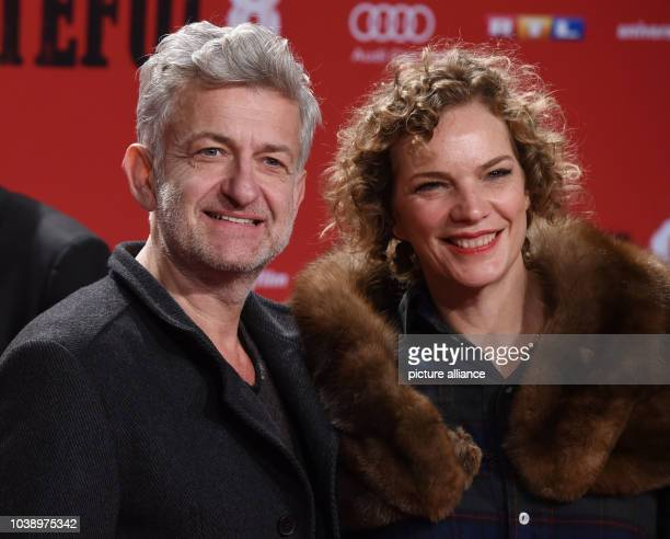 Actor Dominic Raacke and his girlfriend Alexandra Rohleder arrive to the German premiere of the movie 'The Hateful 8'at Zoo Palast in BerlinGermany...