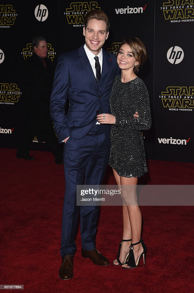 Actor Dominic Sherwood (L) and actress Sarah Hyland attend Premiere of Walt Disney Pictures and Lucasfilm's 'Star Wars: The Force Awakens' on December 14, 2015 in Hollywood, California.