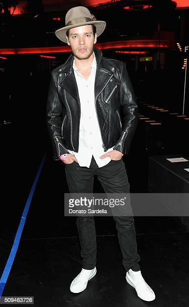 Actor Dominic Sherwood in Saint Laurent by Hedi Slimane attends Saint Laurent at the Palladium on February 10 2016 in Los Angeles California for the...