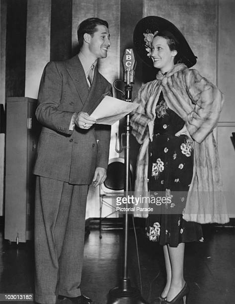 Actor Don Ameche and actress Dorothy Lamour with an NBC microphone in a publicity image for the radio show 'The Chase and Sanborn Hour' USA 20 May...