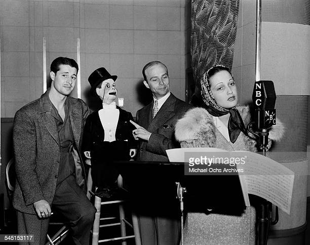 Actor Don Ameche Charlie McCarthy ventriloquist Edgar Bergen and actress Dorothy Lamour on set during a Radio Show in Los AngelesCA