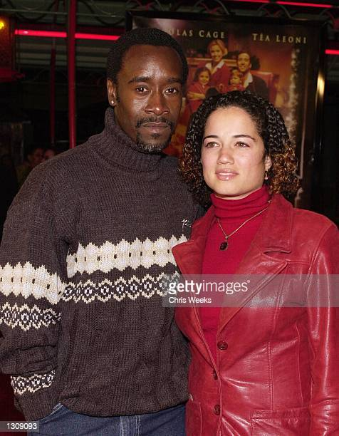 Actor Don Cheadle and a companion arrive at the Universal Pictures and Beacon Pictures premiere of 'The Family Man' December 12 2000 at Mann''s...