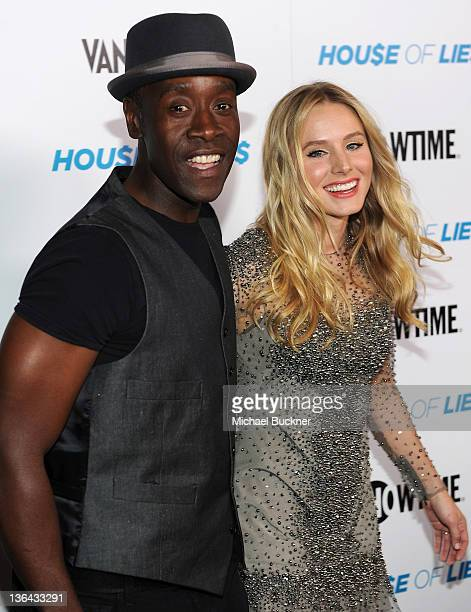 Actor Don Cheadle and actress Kristen Bell arrive at the premiere screening of Showtime's Hou$e of Lie$ at the ATT Center on January 4 2012 in Los...