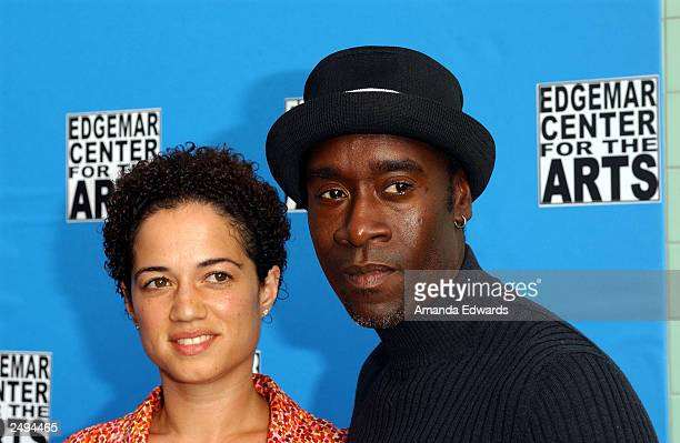 Actor Don Cheadle and his girlfriend actress Bridgid Coulter arrive at the fundraising reception and ceremonial ribbon cutting at the new Edgemar...